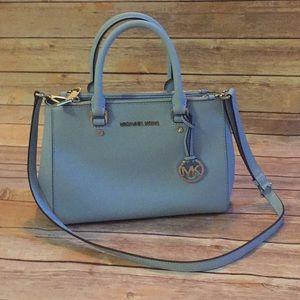 Michael Kors Handbag in light blue.